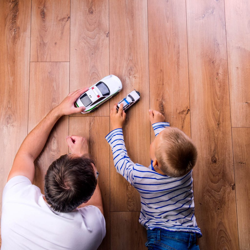Father with kid playing with toycar | Leaf Floor Covering